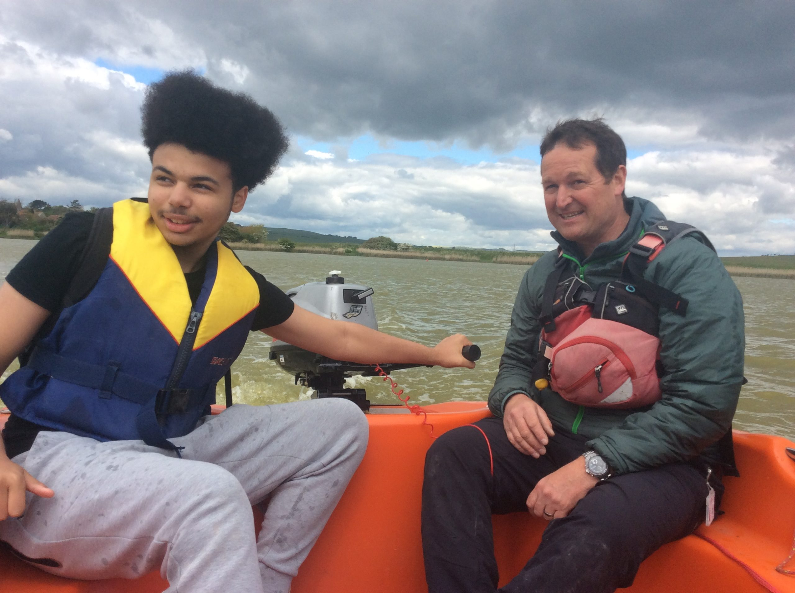 This is a picture of St. John's School learner Louie Jacobs (left) with Andy Hamilton, Outdoor Education teacher at St. John's School, sailing on Piddinghoe lake